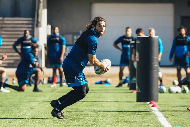 Dan Stone passing a rugby ball during a Colorado XO rugby practice
